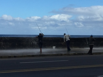 Locals fishing along the Malecon